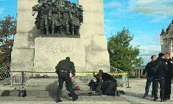 An Ottawa police officer runs with his weapon drawn outside Parliament Hill in Ottawa on Wednesday Oct. 22, 2014.   – AP Photo