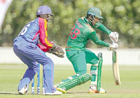 Saif Hassan of Bangladesh playing a shot during their match against Nabibia in the ICC U-19 World Cup at Bert Sutcliffe Oval, Lincoln on Saturday. 	photo: BCB