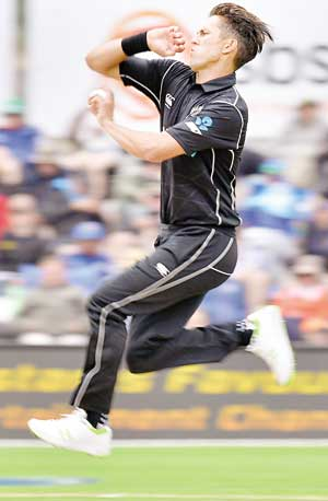 New Zealand's Trent Boult bowls during the third one day international cricket match between New Zealand and Pakistan at University Oval in Dunedin on Saturday.	photo: AFP
