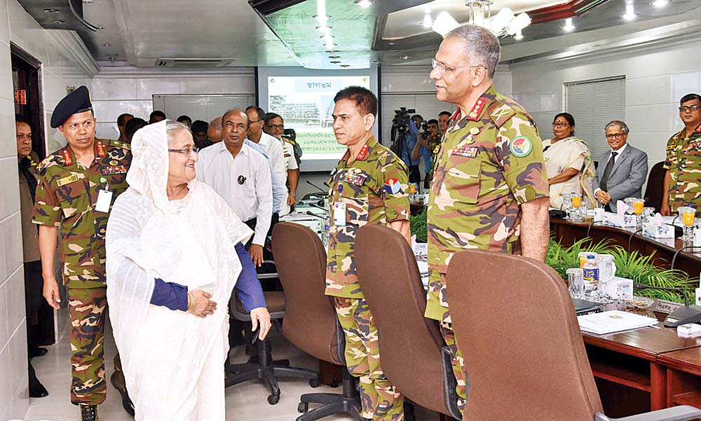 Governing Body members of the National Defense College (NDC) and Defense Services Command and Staff College (DSCSC) welcome Prime Minister Sheikh Hasina at the 16th joint meeting of the body in Dhaka Cantonment on Sunday. photo : BSS