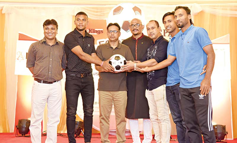 2003 SAFF champion team captain Rajani Kanta Barman handing over the ball to the current booters of national team in the presence of BFF senior vice president Abdus Salam Murshedy, vice president Arif Khan and Daily Kaler Kantho Deputy Editor Mustafa Mamun in a programme of BSPA on Friday in Dhaka. 	photo: Bspa