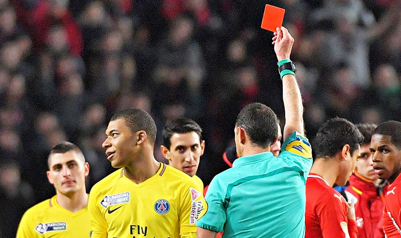 (FILES) In this file photograph taken on January 30, 2018, Paris Saint-Germain's French forward Kylian Mbappe (L) reacts as the referee gives him a red card during the French League Cup football semi-final match between Rennes and Paris Saint-Germain at the Roazhon Park stadium in Rennes.	photo: AFP