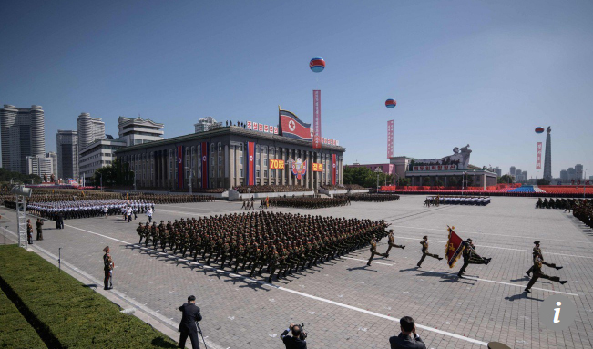 North Korea on Sunday held a military parade without showing any intercontinental ballistic missiles to mark its 70th birthday.