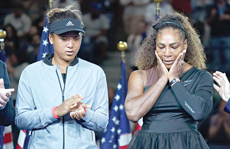 US Open Womens Single champion Naomi Osaka of Japan (L) with Serena Williams of the US during their Women's Singles Finals match at the 2018 US Open at the USTA Billie Jean King National Tennis Center in New York on September 8, 2018.	photo: AFP