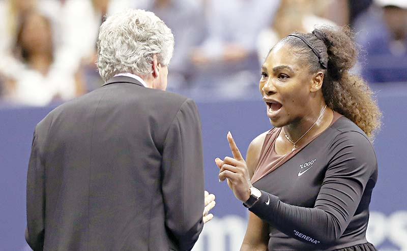 Serena Williams of the United States argues with referee Brian Earley during her Women's Singles finals match against Naomi Osaka of Japan on Day Thirteen of the 2018 US Open at the USTA Billie Jean King National Tennis Center on September 8, 2018 in the Flushing neighborhood of the Queens borough of New York City.	photo: AFP