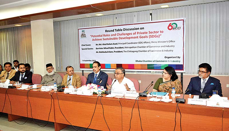 Abul Kalam Azad, Principal Coordinator (SDG Affairs), Prime Minister's Office, flanked by other participants speaking as the chief guest at a round table discussion in Dhaka on Thursday.