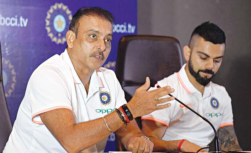In this file photo taken on June 22, 2018 Indian cricket team head coach Ravi Shastri (L) speaks as captain Virat Kohli looks on during a press conference in New Delhi.photo: AFP