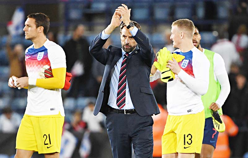 England's manager Gareth Southgate applauds fans after winning a friendly international football match between England and Switzerland at the King Power stadium in Leicester on September 11, 2018.	photo: AFP