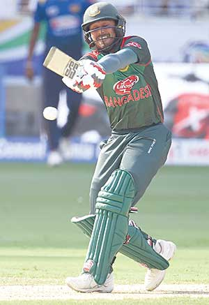 Bangladeshi batsman Mohammad Mithun plays a shot during ODI