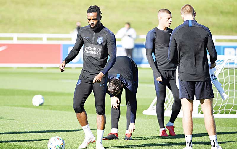 England's midfielder Nathaniel Chalobah (L) attends an open training session at St George's Park in Burton-on-Trent, central England on October 9, 2018 ahead of their UEFA Nations League match against Croatia on October 12.	photo: AFP