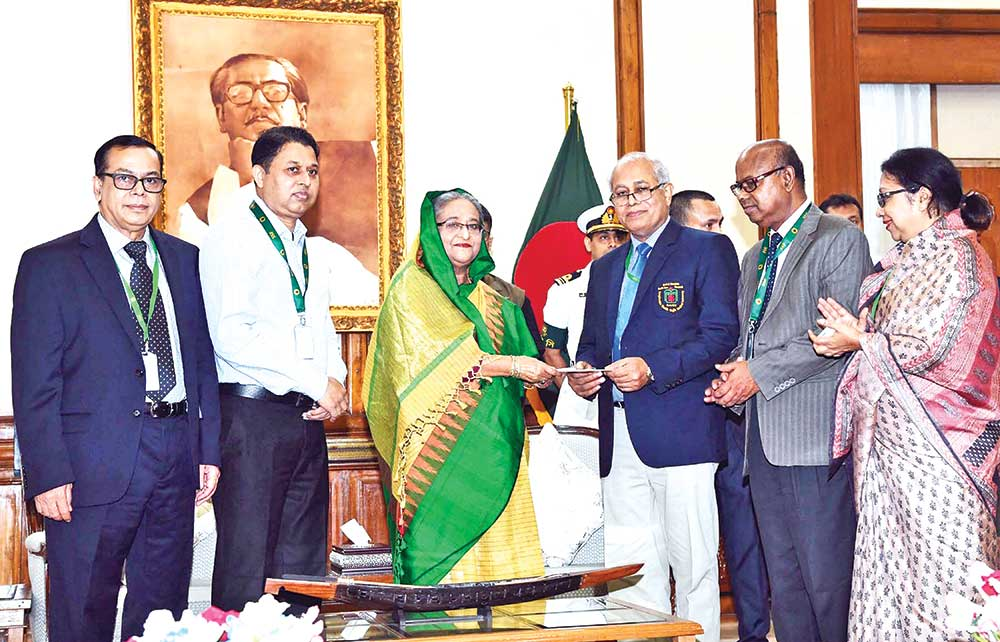 Prime Minister Sheikh Hasina donated Taka 10 crore in aid of the poor patients of Bangabandhu Sheikh Mujib Medical University (BSMMU). BSMMU Vice-Chancellor Professor Dr Kanak Kanti Barua received the cheque for the money at a function at Ganabhaban on Thursday. photo: pid