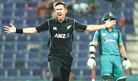 New Zealand cricketer Trent Boult (L) celebrates after he dismissed Pakistan batsman Babar Azam during the first one day international (ODI) cricket match between Pakistan and New Zealand at the Sheikh Zayed Cricket Stadium in Abu Dhabi on Wednesday. 	photo: AFP