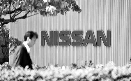 Nissan first-half profit slumps on rising costs