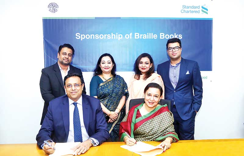 SCB Bangladesh CEO Naser Ezaz Bijoy and Founder of Sporsho Nazia Jabeen signing an agreement at a ceremony held in the capital recently.	photo: Bank