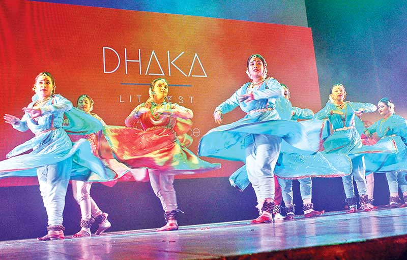 Artistes performing a dance number after the opening of the 8th edition of Dhaka Lit Fest (DLF), an internationally recognised literary festival, kicked off at Abdul Karim Shaihittya Bisharad Auditorium of Bangla Academy on Thursday.	photo : Observer