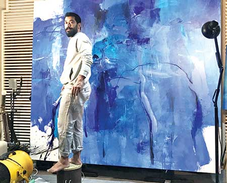 Rashid Khan paints on his canvas