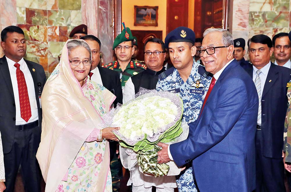 President Abdul Hamid greets Prime Minister Sheikh Hasina on her arrival at Bangabhaban on Thursday.	photo : pid