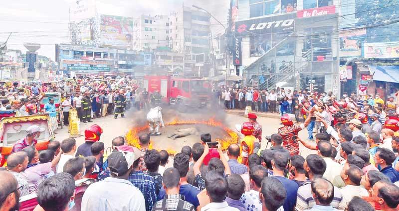 Fire Service members held a drill at the Satmatha of Bogura
