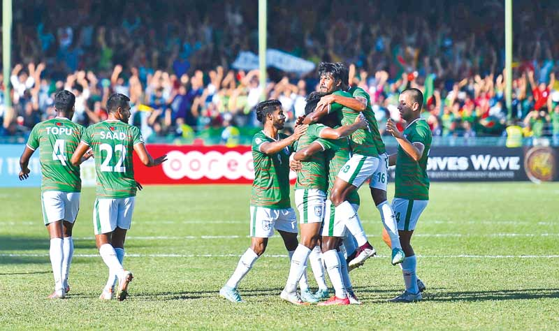 Players of Bangladesh celebrating after scoring a goal in the last group match of the 2021 SAFF Championship against Nepal at Male National Stadium on Wednesday. photo: BFF