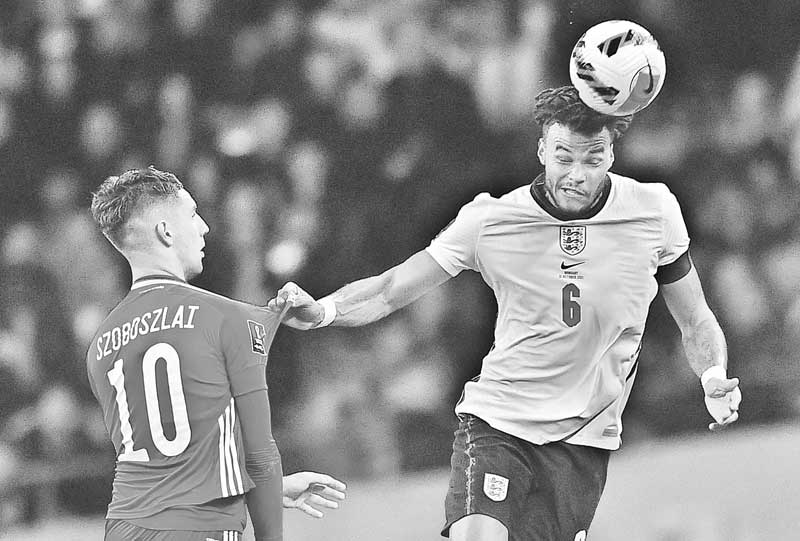 Hungary's midfielder Dominik Szoboszlai (L) vies with England's defender Tyrone Mings as he headers the ball during the FIFA World Cup 2022 qualifying match between England and Hungary at Wembley Stadium in London on October 12, 2021.photo: AFP