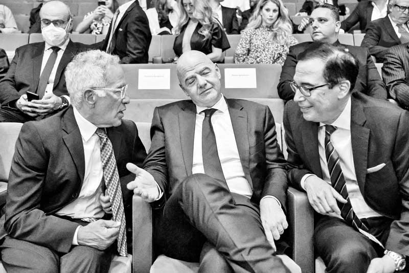 """(L to R) Israeli-Canadian billionaire cyclist and businessman Sylvan Adams, FIFA President Gianni Infantino, and former US secretary of the treasury Steve Mnuchin speak together as they attend the launch of the """"Friedman Center for Peace through Strength"""" at the Museum of Tolerance Jerusalem on October 11, 2021."""